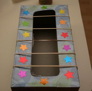 Make a fun guitar craft for your kids out of an empty tissue box.
