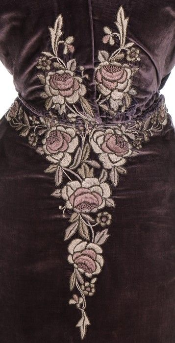 A rare Liberty & Co Aesthetic movement dress, circa 1910. woven yellow on white silk label 'Liberty & Co, London & Paris', embroidered with Japanese inspired raised-work roses in shades of mauve and grey, trained skirt
