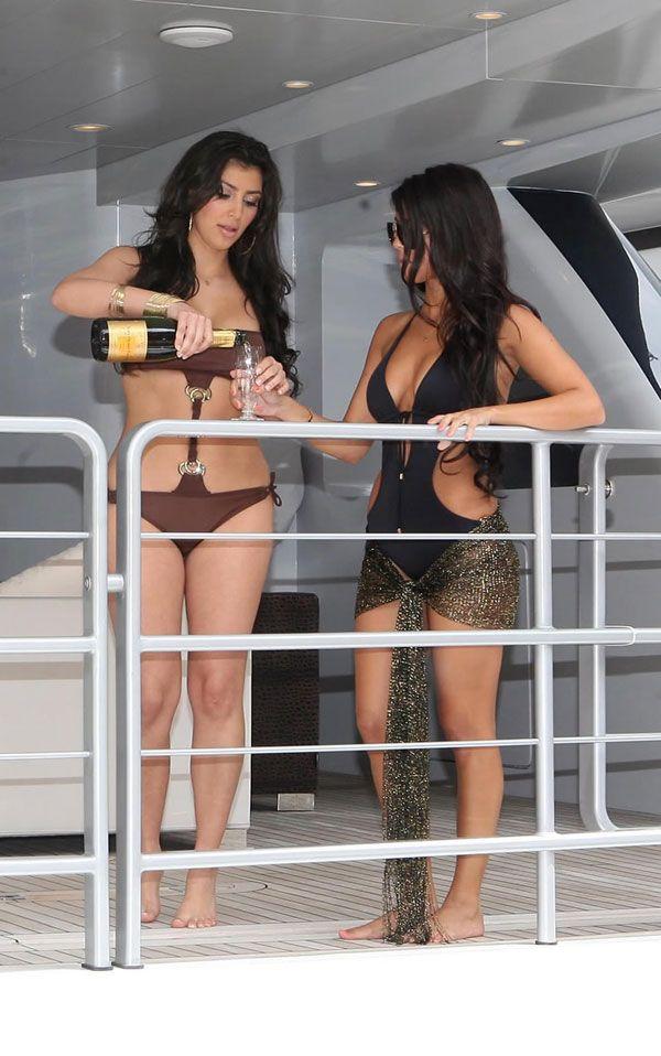 [IMG]http://www.drunkenstepfather.com/cms/ul/20080616-kim-kardashian-bikini-15.jpg[/IMG]