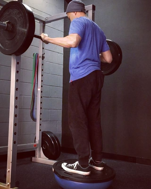 Adding instability to barbell squats. ✔️Unstable surface work forces you to lift lighter while also developing balance and proprioception. ✔️The unstable surface also requires you to concentrate on technique and weight distribution to be successful.