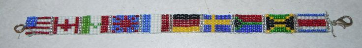 """Flags of the World"" bracelet/anklet I made on a bead loom. Flags in order from left to right are: United States, Canada, Mexico, Great Britain, France, Germany, Sweden, South Africa, Jamaica, and Costa Rica"