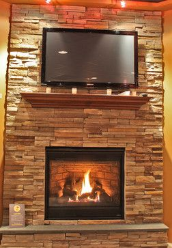 Rock veneer fireplace