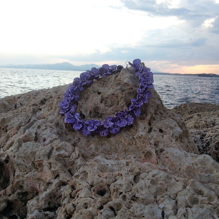necklace with handmade purple petals of polymer clay
