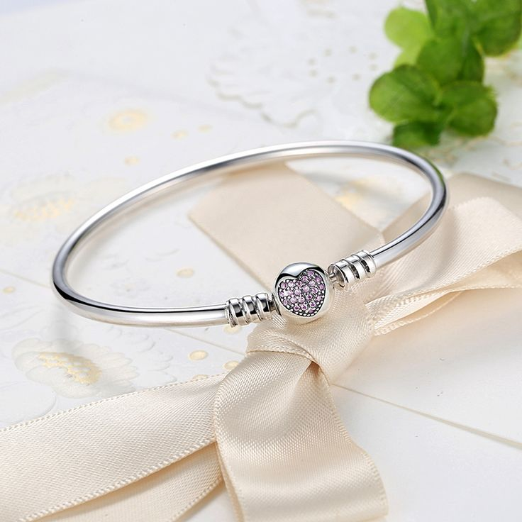 You are sure to fall in love with this beautiful sterling silver charm bracelet. The perfect carrier for your personal love story, this snake-chain style features a ball clasp adorned with dazzling cubic zirconia stones in a heart-shaped motif.