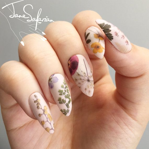 Pressed Dried Flowers Design Water Slide Nail by jsfrnNailArt. I love floral and I love nails, so this nail art is something I definitely have to try out.