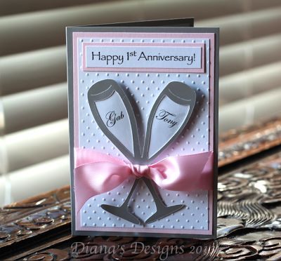 Happy first anniversary to the bride and groom!  Champagne flutes from Cricut Wedding Solutions cartridge. #DianasDesigns