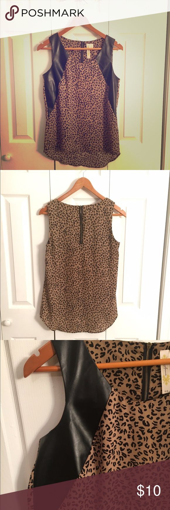 Cheetah Print Tank w/ Suede Detail &I Exposed Zip This cheetah print shirt is a nicely toned down color so that it can be dressed up or down. The dark brown suede details near the arms create a nice breakup of the pattern, and the exposed zipper in the back is a cute detail! Tops Tank Tops