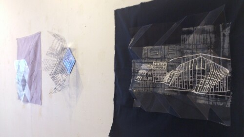 'Uniform' folded acetate and textile with architectural images.