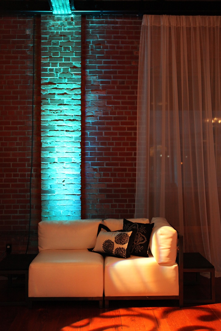 Great way to use the existing venue brick walls and create contrast with the light & airy drape.  Corporate event at the Laurel All Occasions Party & Event Rentals, Kelowna BC