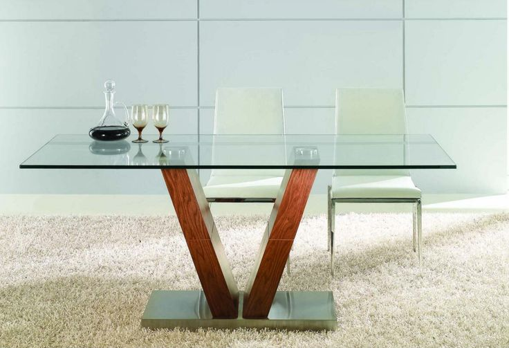 A refined union of glass, metal, and wood, the Key Dining