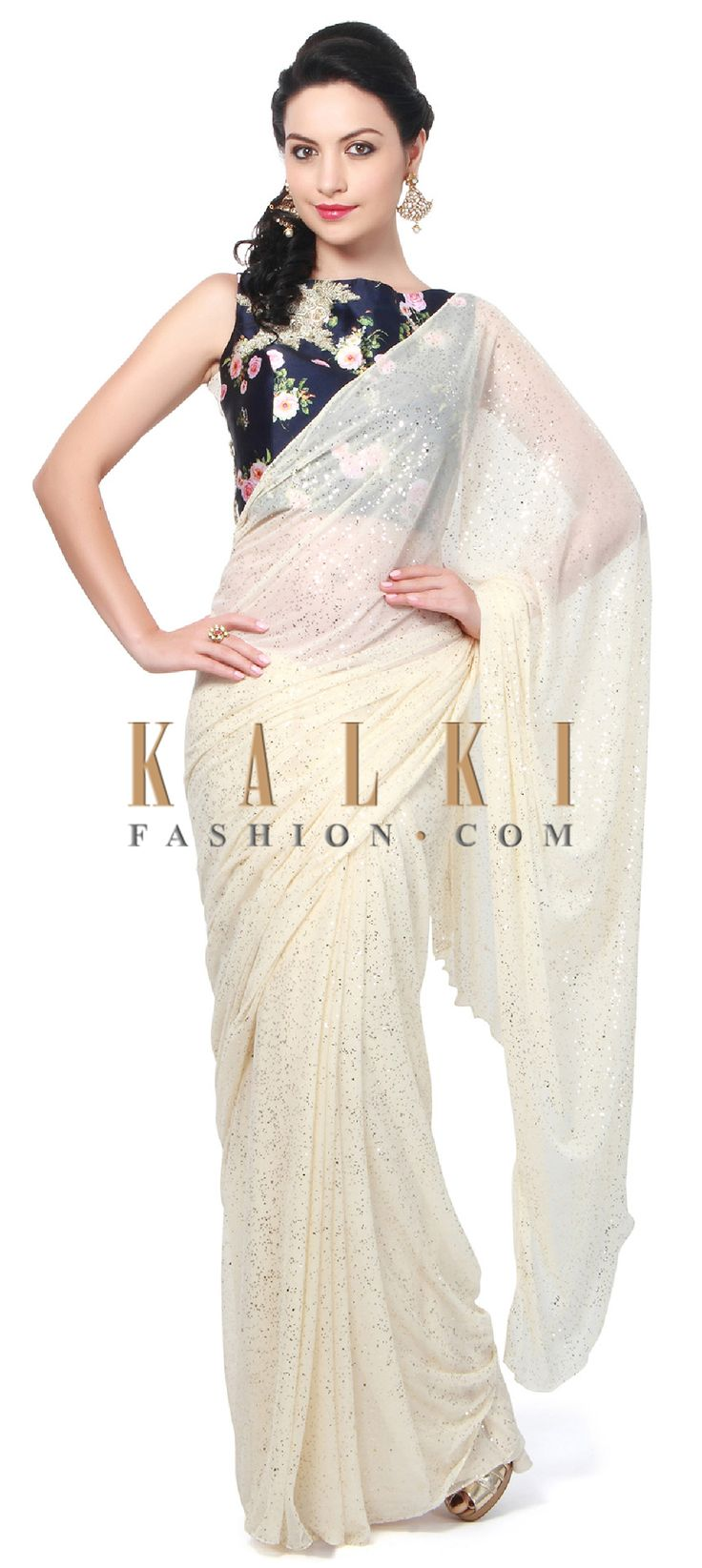 Buy Online from the link below. We ship worldwide (Free Shipping over US$100). Product SKU - 315466.Product Link - http://www.kalkifashion.com/off-white-saree-features-with-contrast-floral-blouse-only-on-kalki.html