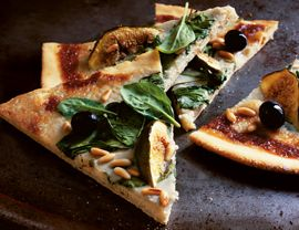 Gorgonzola, fig, & spinach pizza  Addition: 1/4 c balsamic vinegar + 1 tsp honey, cook for 3-5 min while pizza is baking and drizzle the reduction onto finished pizza.