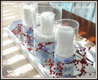 Dollar Tree vases with candles resting on salt (regular, old table salt),, wrapped in Dollar Tree ribbon on a tray with branches. This centrepiece could be left up for January as it is not Christmas specific.