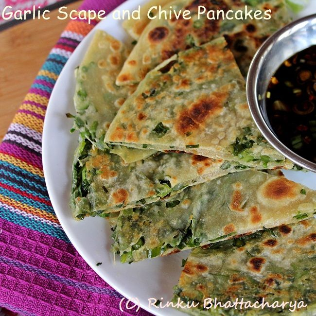 A seasonal riff scallion pancakes with addition of chives, garlic scapes and cilantro.