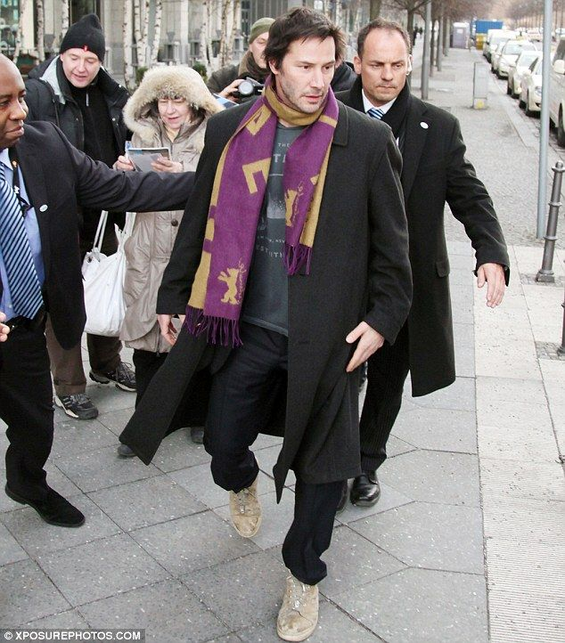 Keanu Reeves, pictured in Berlin today, became the subject of fans on the web who claimed he was a vampire