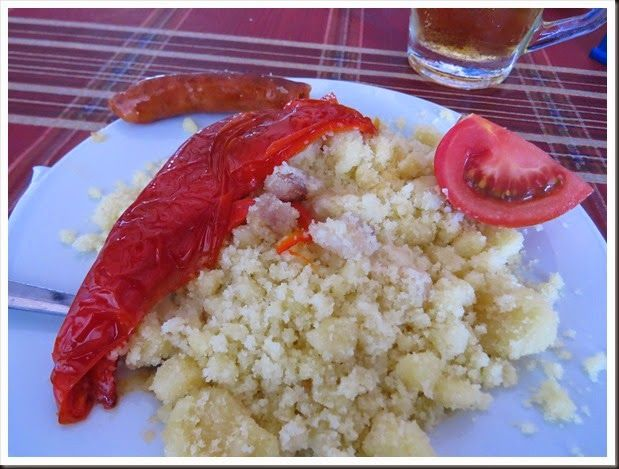 A traditional Spanish tapa from the Almeria. It is called migas and it is literally fried bread crumbs. It is so good! #food #spain #tapa