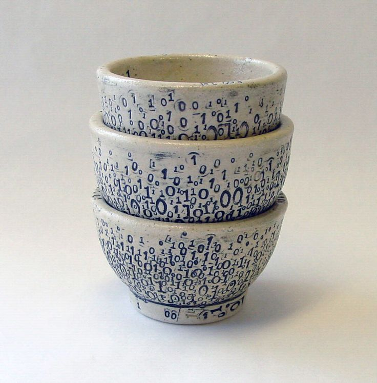 From her small studio in rural Alaska, artist Laura C. Hewitt fuses the technological with the handmade, producing cyberpunk dishware and cyborg decor from wheel-thrown ceramics. A recurring theme in her work are plates, cups, and bowls speckled with 0's and 1's formed by vintage alphanumeric and pu