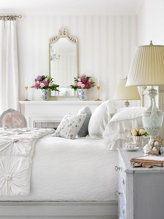 An airy palette makes this master bedroom feel clean and sophisticated - Traditional Home® Photo: Emily Followill Design: Lillian August