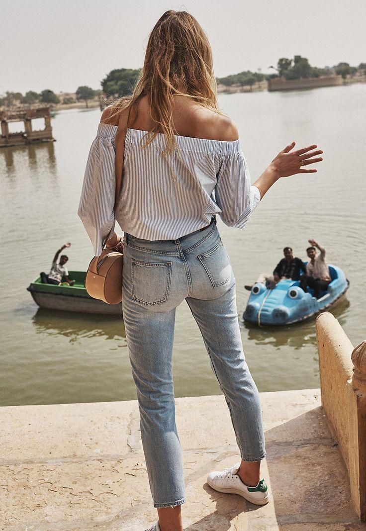 Off the shoulder striped top, light wash jeans