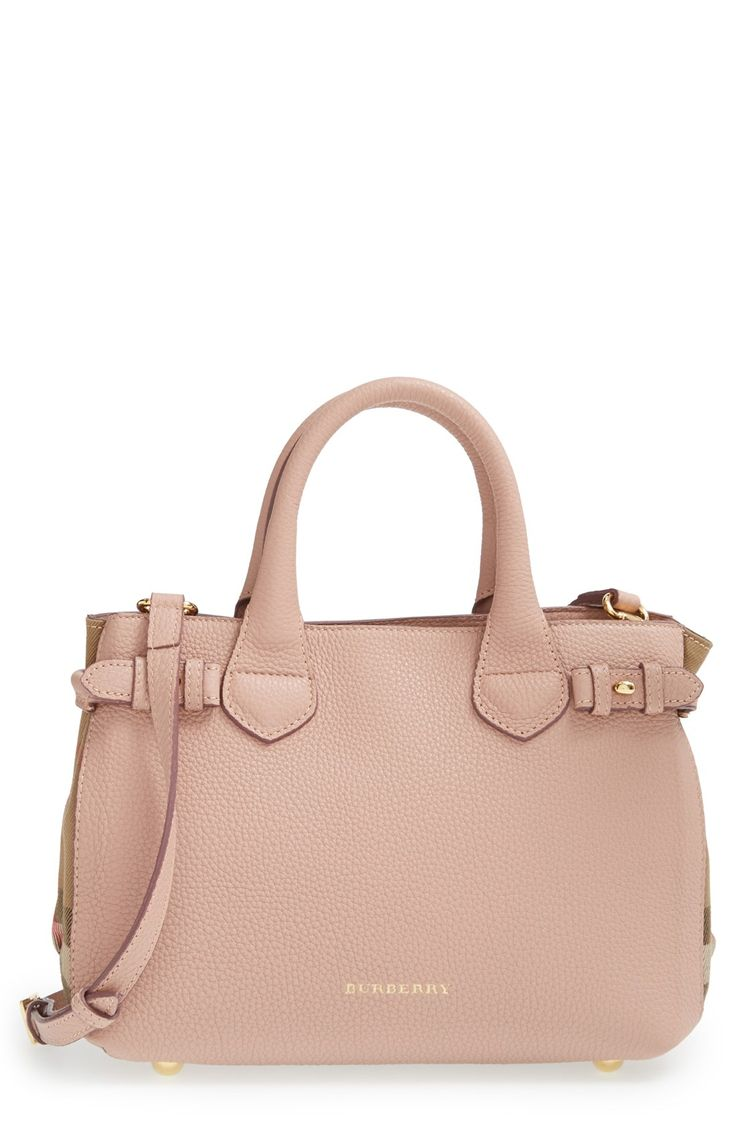 Lusting over this leather tote from Burberry. The blush color, Burberry check print sides, and gold hardware make it a classic piece perfect for everyday wear.