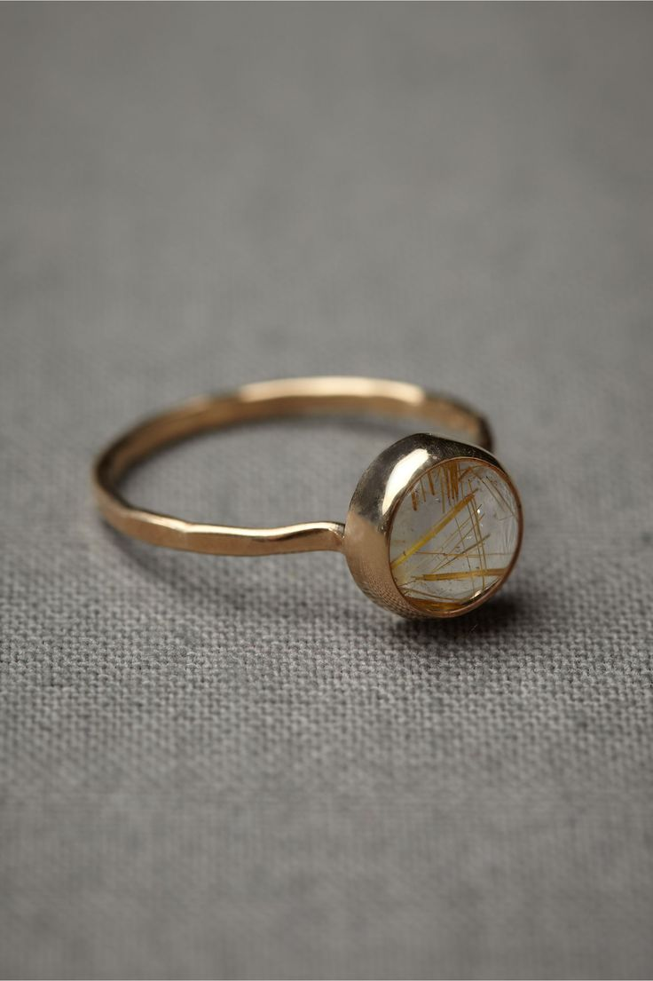 "Melissa Joy Manning highlights the organic beauty of rutilated quartz, presenting it in a simple halo of 14k gold. 0.3"" diameter stone. 14k yellow gold, rutilated quartz. Handmade in USA."