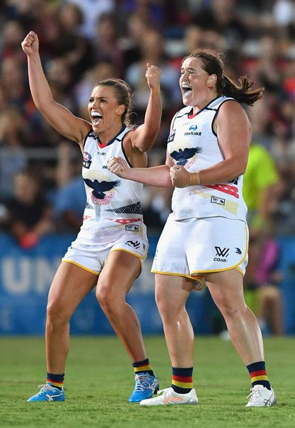 Abbey Holmes and Sarah Perkins of the Crows celebrate a goal during the round two AFL Women's match between the Western Bulldogs and the Adelaide Crows at Whitten Oval on February 10, 2017 in Melbourne, Australia.