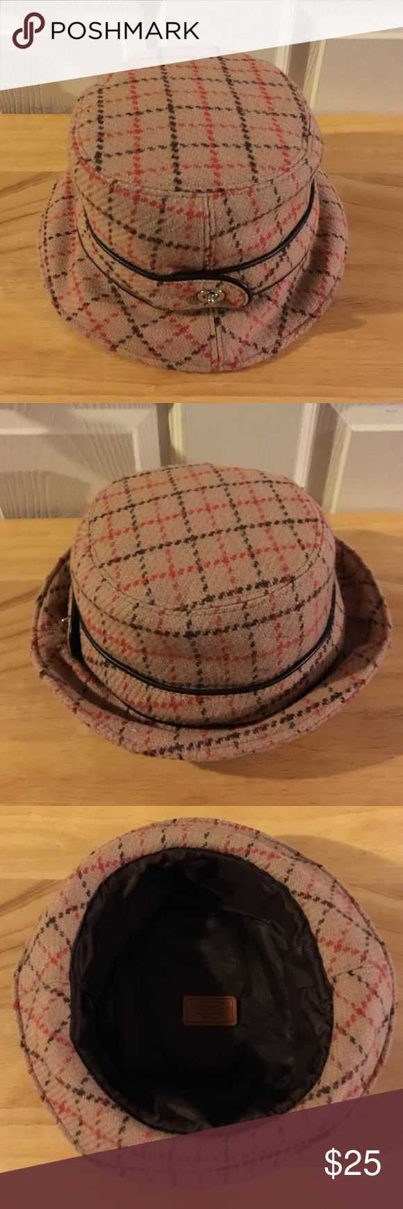 COACH HAT COACH Wool bucket hat. Silver tone turn lock on side. Brown nylon lining. Size P/S. Tan plaid pattern. Band around Hat has brown leather on it. Like new🌸 Coach Accessories Hats