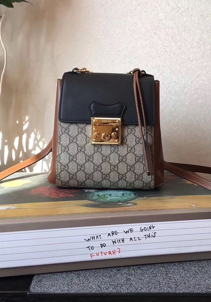 09c94b1276d The most important aspect of the Gucci Padlock GG Supreme backpack is the  lock with a