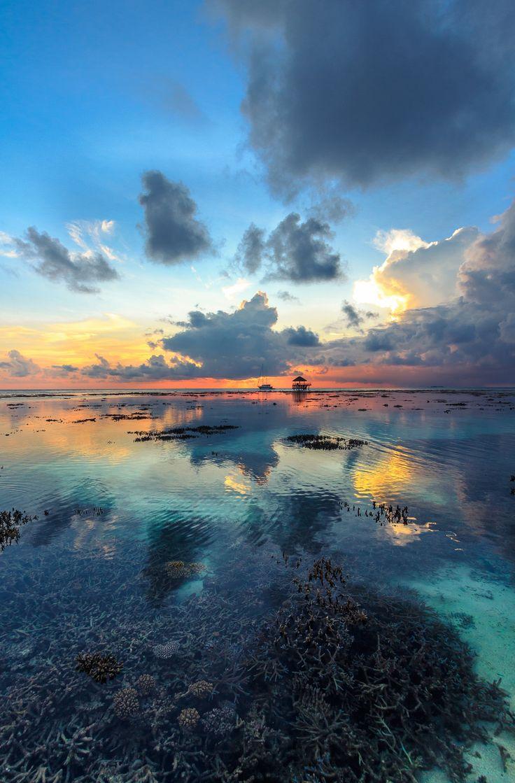 Amazing sunset at Kandolhu resort in Maldives