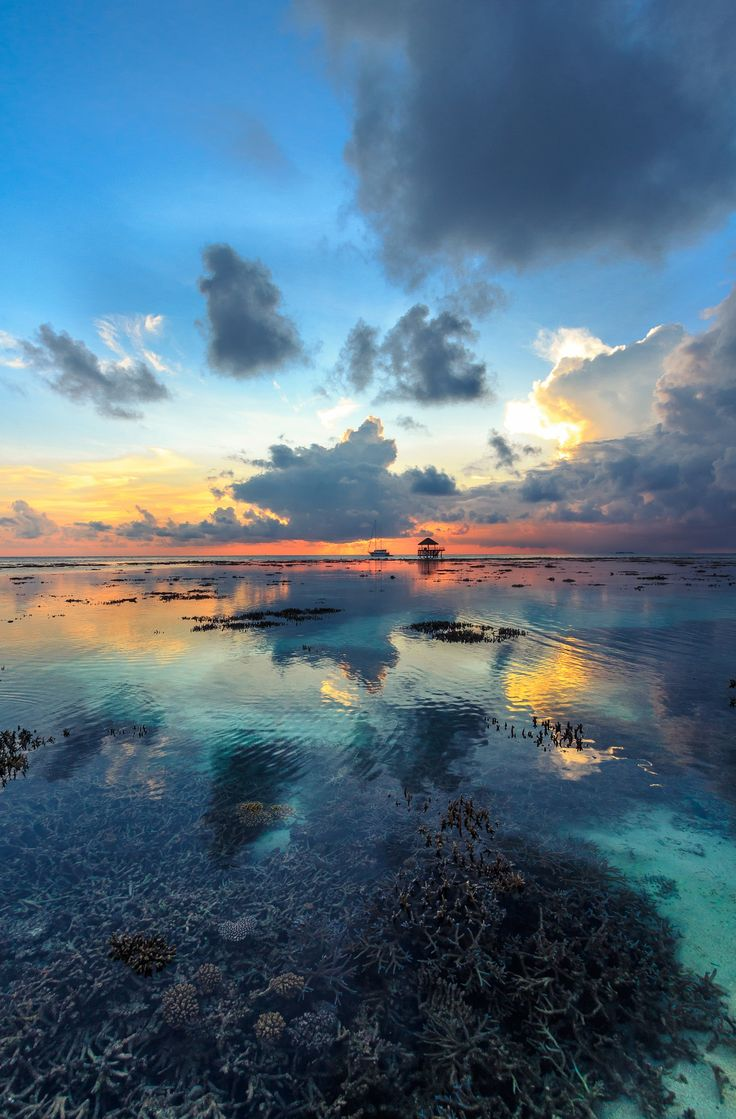 Amazing sunset at Kandolhu resort in Maldives