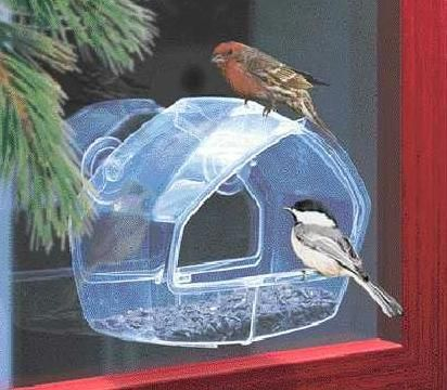 """3488  Window Feeder. Clear Plastic. Comes with 2 suction cups. Approx. 8"""" x 7""""."""