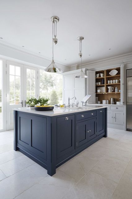 I saw a great example of a muted navy kitchen island with white kitchen cabinets that would look fab with your dining table (refreshed with a darker stain, pale gray linen upholstery and upholstery tacks to match your couch.)