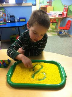 Write the arabic lette in colored rice! Awesome for developing sensorimotor skills and learning to write w/o paper and pencil