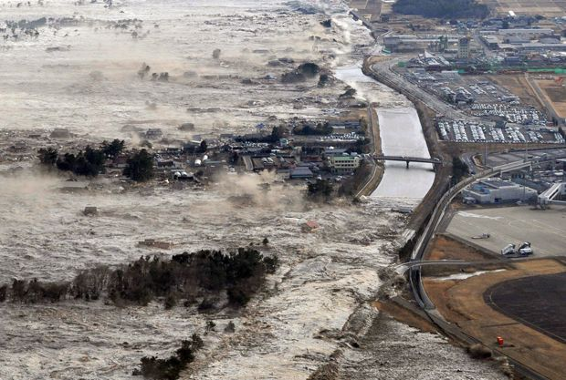 A tsunami hits the north-east coast of Japan after a magnitude 9.0 earthquake on March 11, 2011.
