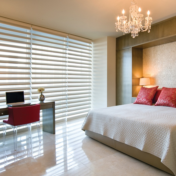 Create an alluring ambiance in a bedroom with the distinctive style and superior light control of Pirouette® window shadings ♦ Hunter Douglas window treatments