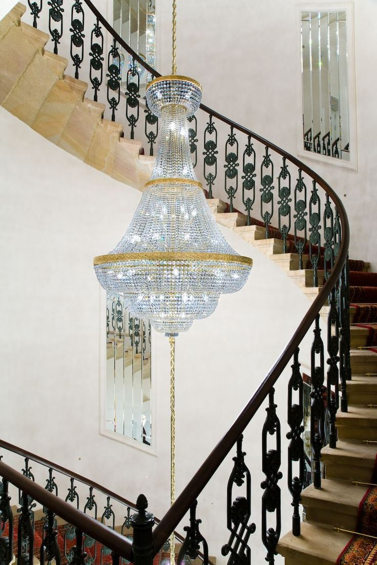 The Bonerowski Palace Hotel in Krakow boasts a staircase coiling around five baskets suspended from one another to create the sense of light ascending. #light #lighting #design #designlighting #interior #interiortrends #crystal #bohemiancrystal #chandelier #hospitality #hotel #staircaselighting #lightinginspirations #lightingtips #preciosa #preciosalighting #preciosainspirations