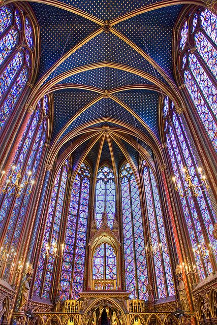 Saint Chapelle, Paris, France. The upper level is encompassed by floor-to-ceiling stained glass windows
