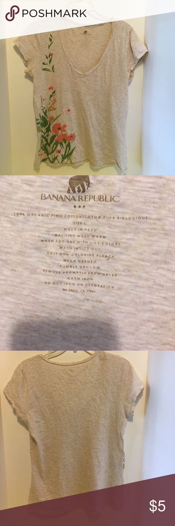 Banana Republic beige tee Banana Republic beige tee organic cotton with orange flowers. Small hole on back left shoulder Banana Republic Tops Tees - Short Sleeve
