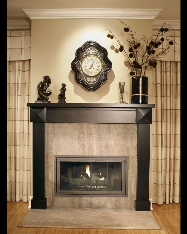fireplace with black tile face wall of wood | Fireplace Mantel Design Idea with Black Flowers, Light Brown Wall ...