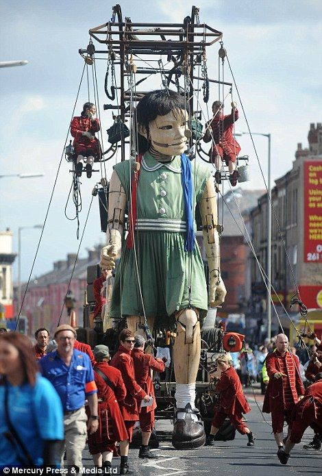 A giant puppet, part of a street theatre production entitled