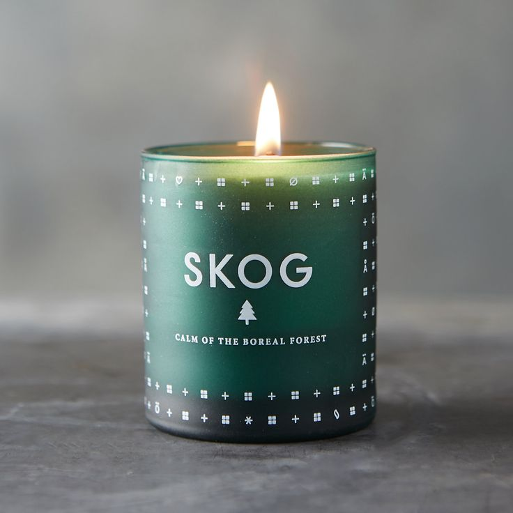 """Named for a Norwegian word meaning """"forest,"""" this candle is inspired by the Boreal forests of Scandinavia. Each candle is hand-poured in F"""