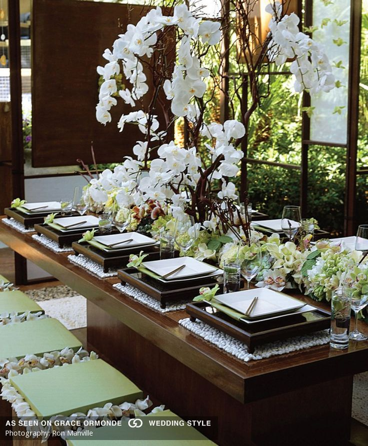 green and white asian tabletop with orchids wedding decor