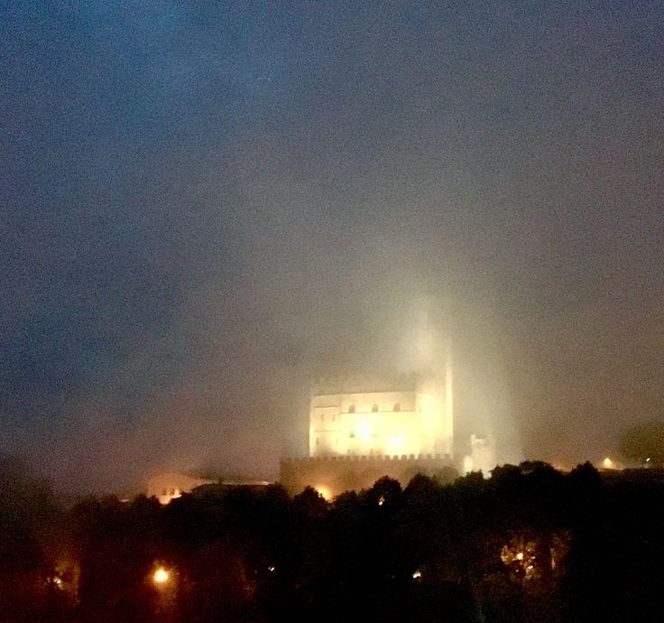 The castle in Poppi taken in a foggy night