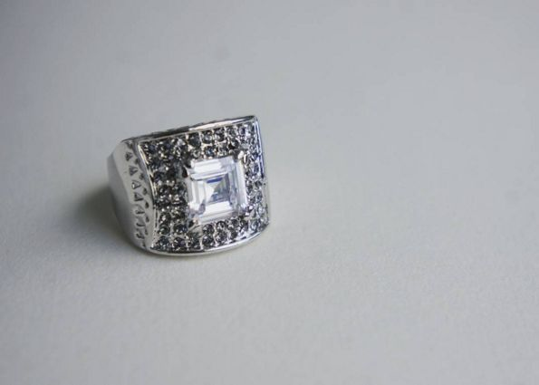 Square Antique Ring: An effortlessly stylish way to create luxurious look, this gorgeous ring adds vintage touch to your outfit. Antique style chunky square crystal ring with surround of encrusted crystals. Real rhdoium electroplated over brass. Adds a chic and vintage touch to any outfit. $109.90