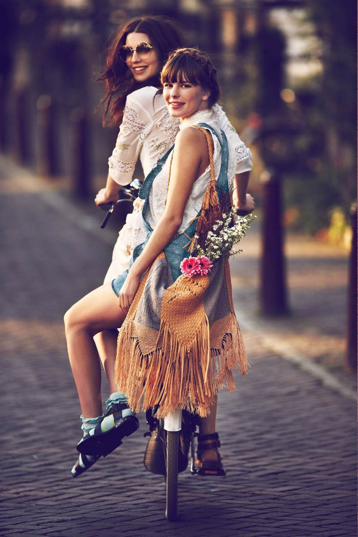 "Girls on Bikes – For its January catalogue, Free People enlists a mix of models and ""real girls"" to wear the latest styles as they ride their bikes in the streets of Amsterdam. Guy Aroch captures the girls in flirty and practical spring pieces including sheer dresses, casual denim, fringe jackets and floral prints. Free People will also sell a limited edition collection of bike apparel for the month of January; the line features hand-painted bike seats, embossed handlebar grips and crotchet…"