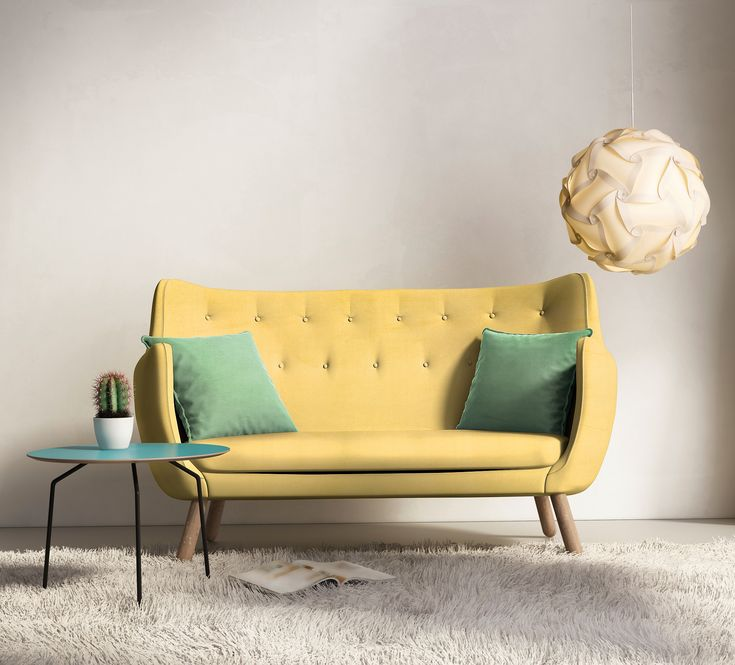 Sofa w skandynawskim stylu ubrana w tkaninę z kolekcji PRESTIGE.