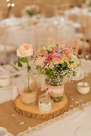 Pastel rustic table centrepieces | Paul and Ann's pretty barn wedding at Larchfield | www.onefabday.com
