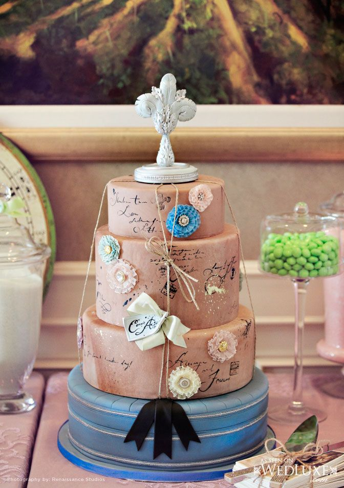 I Love the idea of faux brown paper wedding cake with Love Letters written on it...none of the flowers though