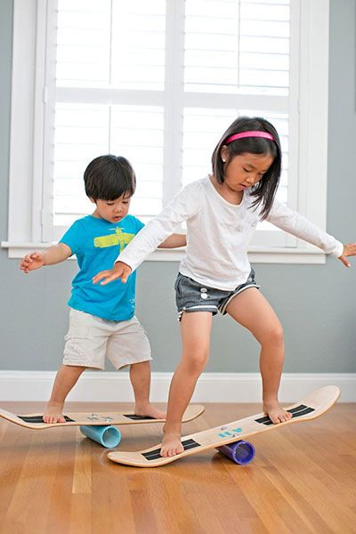 Here's a toy that's safer than a skateboard or an indo board. A piece of PVC pipe bolted to the middle of the underside of a skateboard deck results in an easy three-step balance board to get the little ones rolling enough for them to practice stability but not fast enough to lose control. Via Agnes Hsu, founder of the blog hello, Wonderful.
