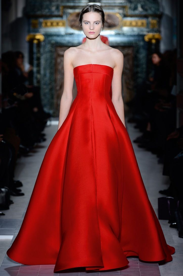 Obsessed with this simple and elegant red gown by Valentino.